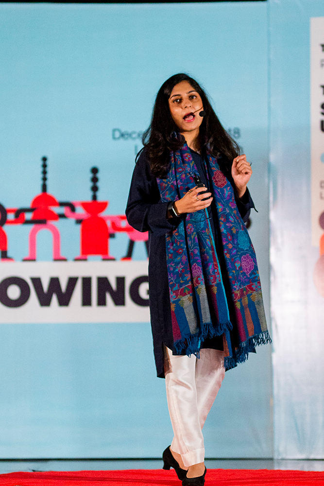 Mehreen onstage delivering a TEDx talk in Lahore